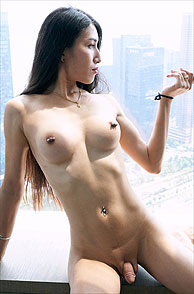 Pierced Nipples Nude Shemale In A Window